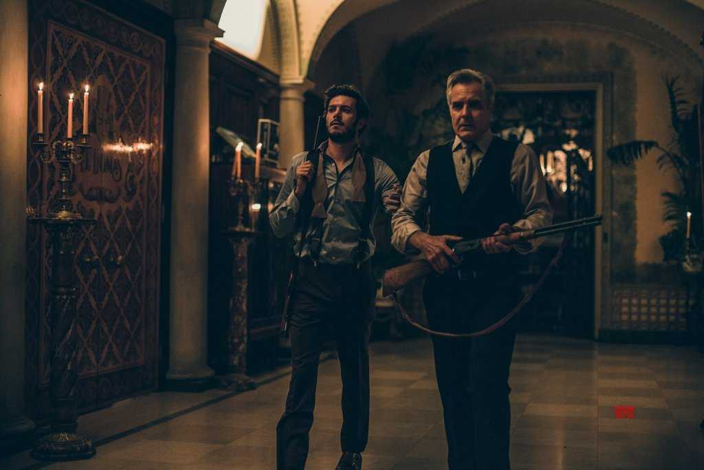 Henry Czerny and Adam Brody in Ready or Not (2019)