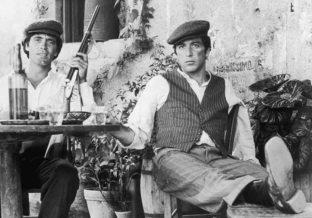 Al Pacino and Franco Citti in The Godfather